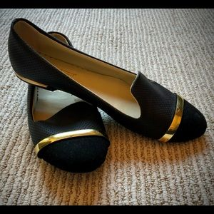 Black flats with gold trim